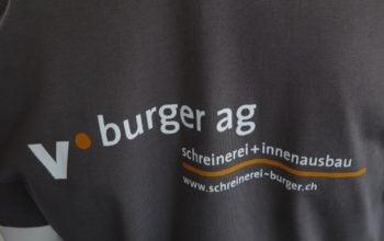 Die T-Shirts wurden mit einem Transfer-Druck veredelt. Kostengünstig und haltbar.